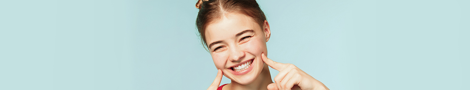 Banner image of young woman smiling wide