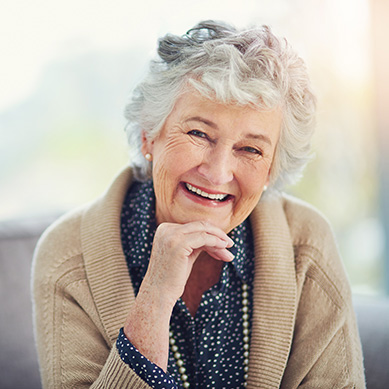 Old Women Smiling With Dental Implants
