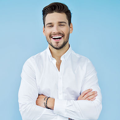Young Guy With A Big White Smile Being Happy About His New Dental Veneers