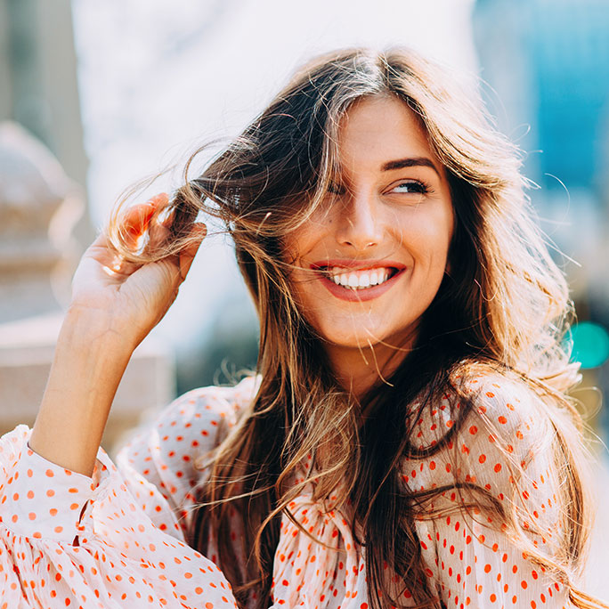 Young Girl With Gorgeous Big White Smile Playing with Her Hair